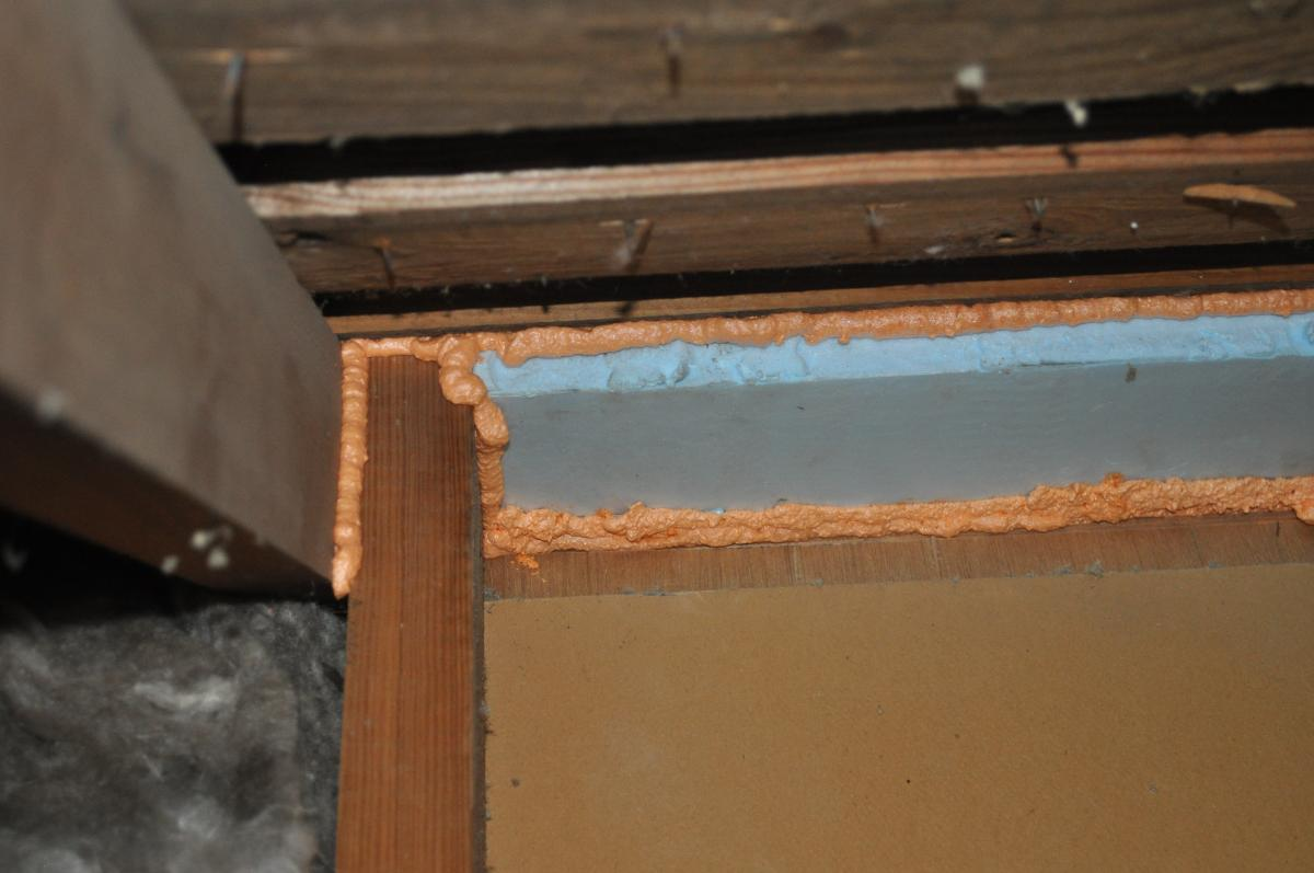 The missing top plate in a kneewall was covered with lumber and rigid foam insulation and then sealed with spray foam