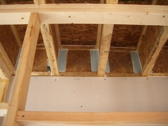 Use caulk or spray foam to air seal all four edges of the blocking material in each joist bay