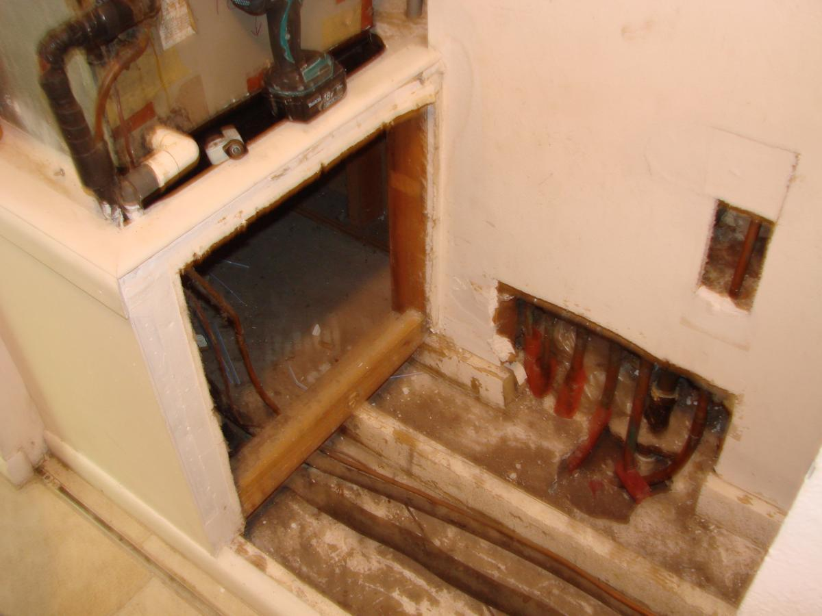 Plumbing access holes in the wall and flooring of the air handler closet allow outside air to be pulled into the air handler