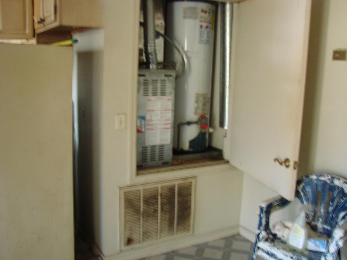 This closet is much too small to provide combustion and make-up air for the naturally aspirated gas furnace and water heater