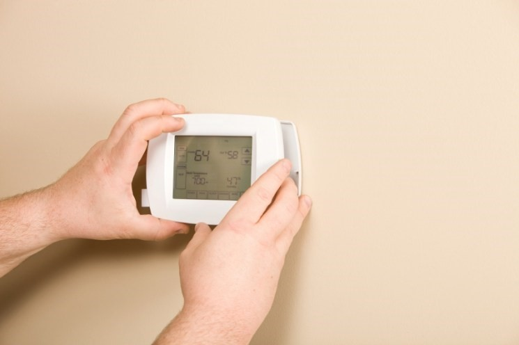 The smart thermostat should slide into the wall plate during installation