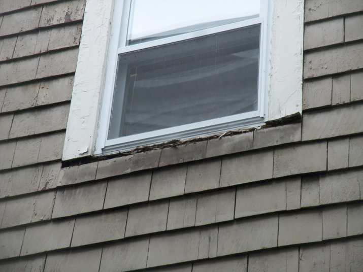 Failed window sill with replacement window installed