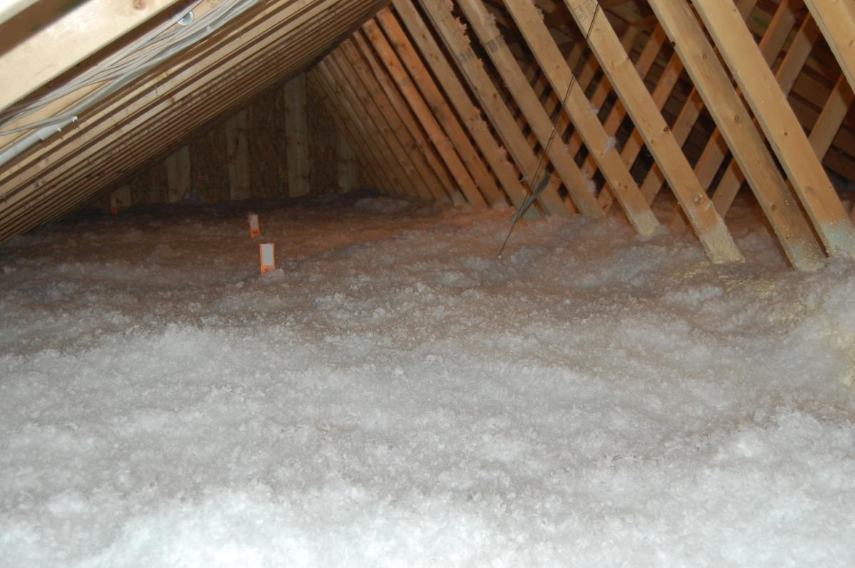 Loose fill installed & Ducts Buried in Attic Insulation | Building America Solution Center