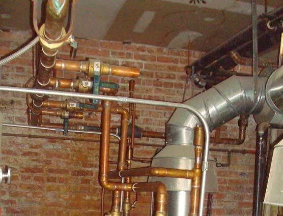 Uninsulated hot water heating pipes