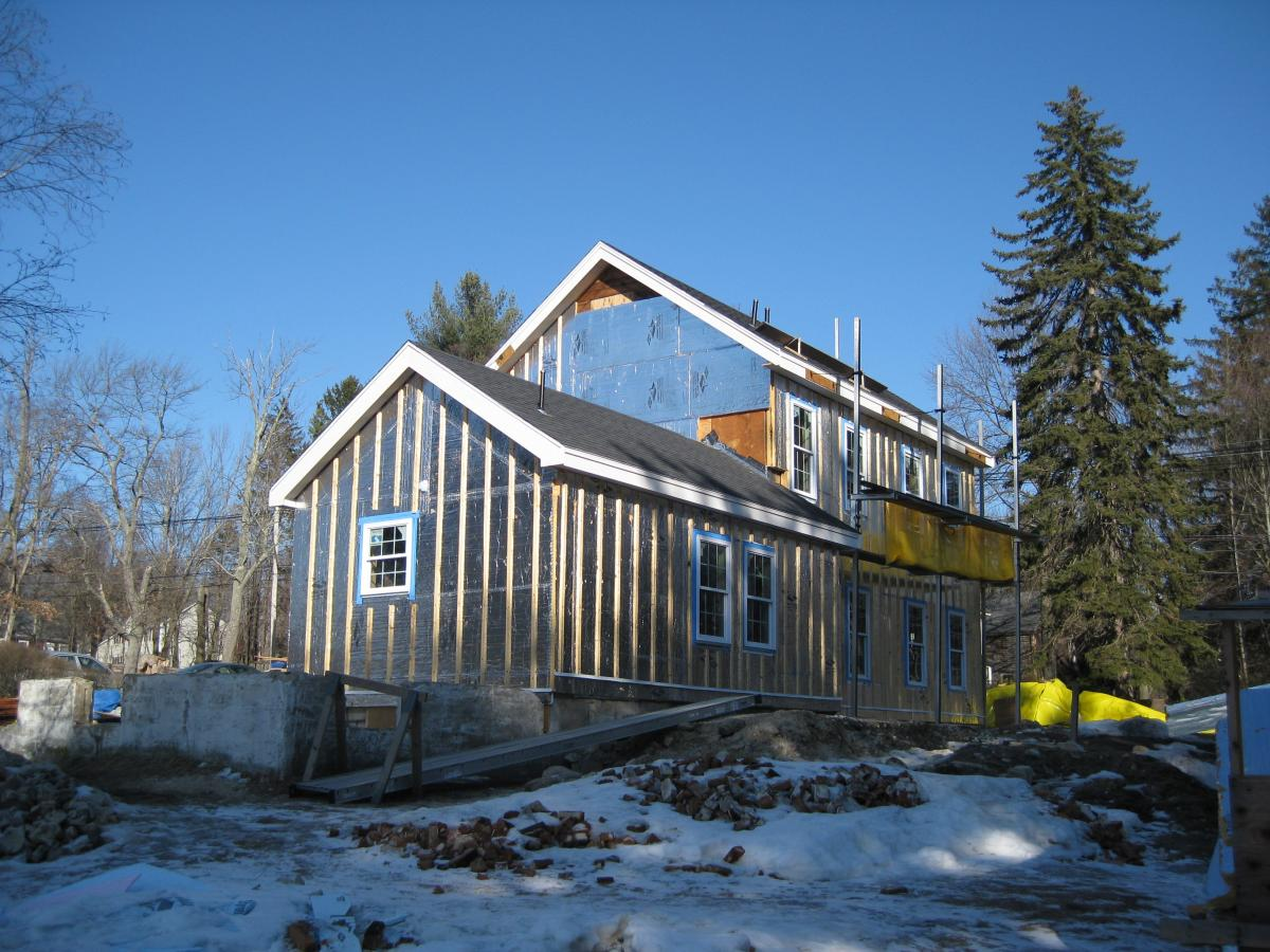 This farmhouse was retrofit by removing existing siding and adding taped insulated sheathing and battens before installing new siding