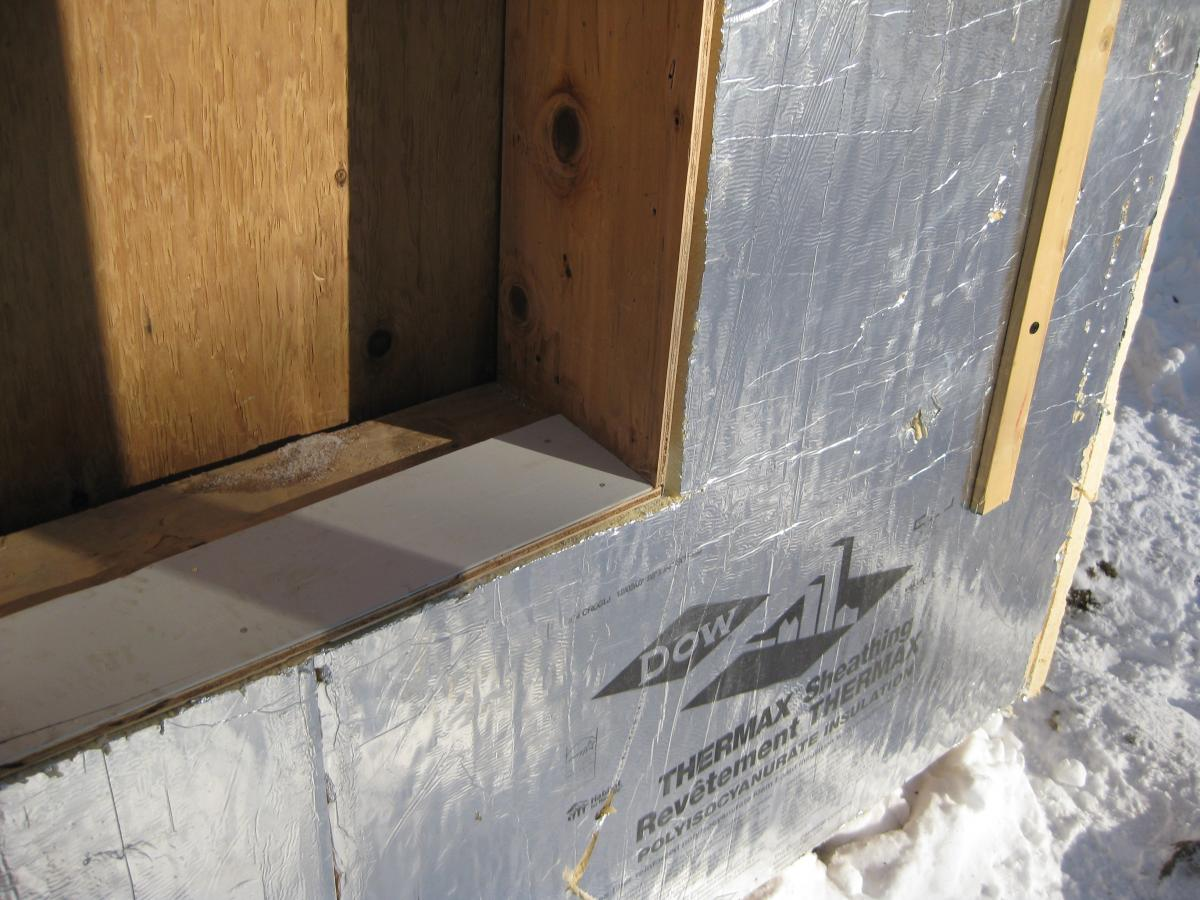 Taped insulating sheathing drainage planes building for Sheathing house wrap