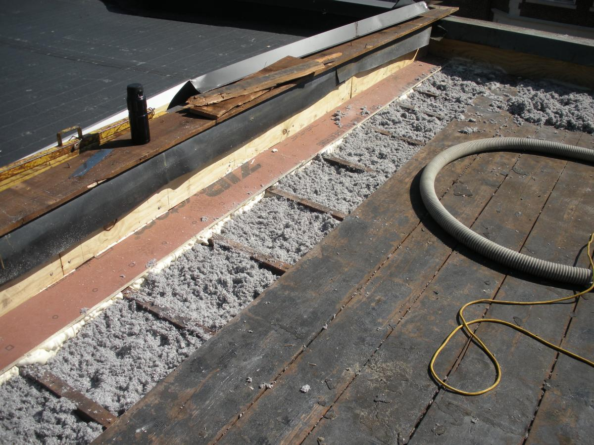 how to create slope on flat roof