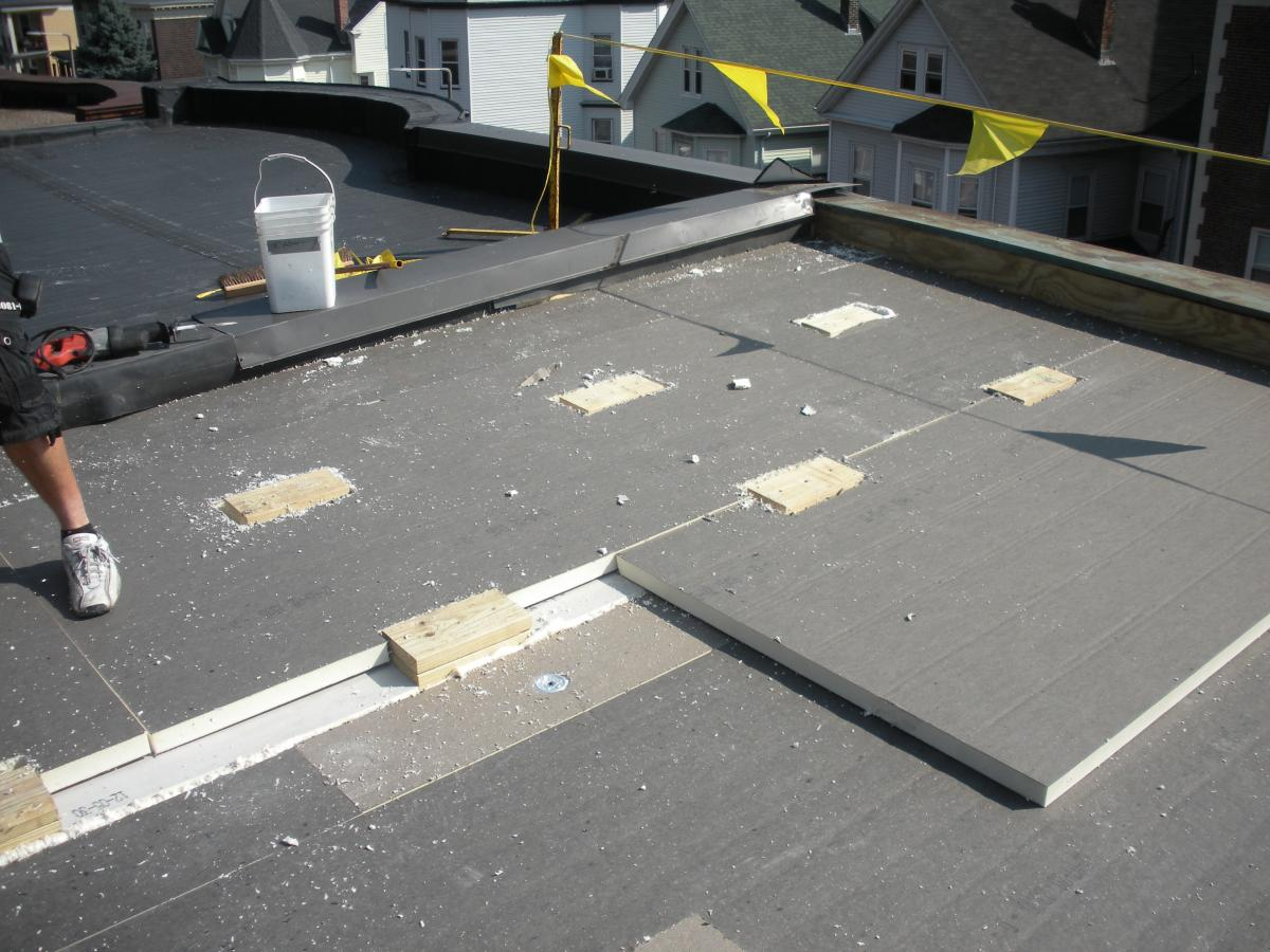 Flat Roof Installation : Water managed roof re roofing and adding insulation over