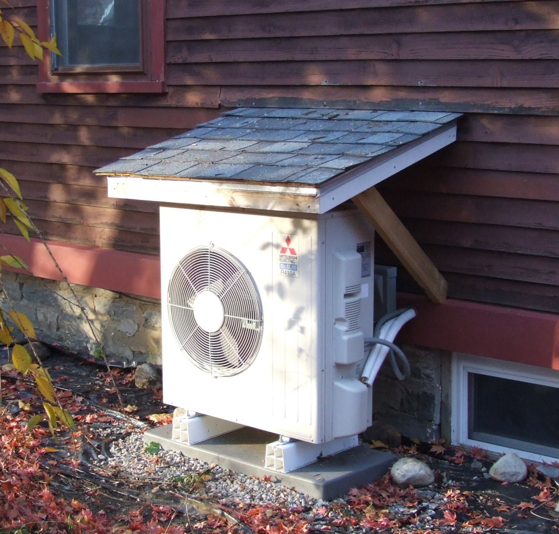 A cover to protect a heat pump from water, snow and ice melt