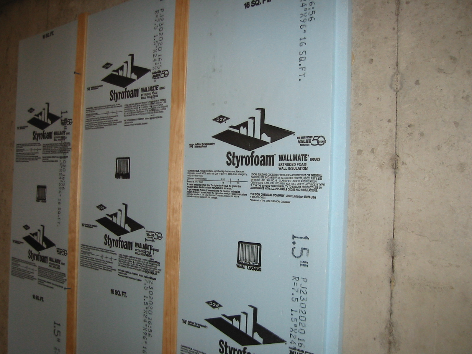 Rigid foam insulation is installed directly in contact with the below-grade basement wall. This stops water vapor from passing into the home and also keeps warm and moist interior air from condensing on the cold walls