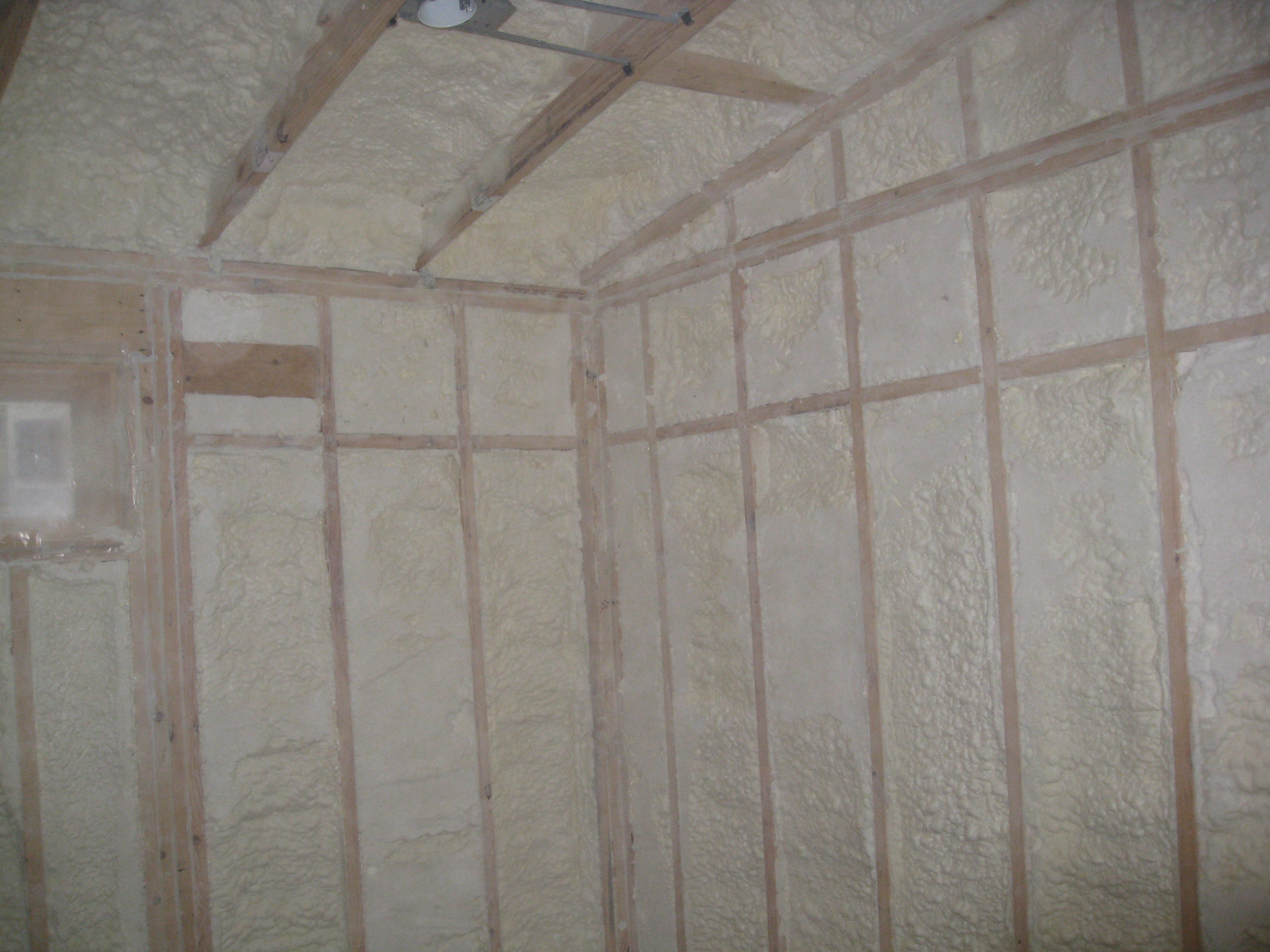 Spray foam insulation is installed in open wall cavities to air seal and insulate