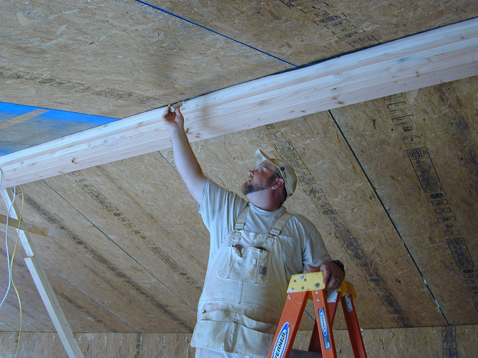 Use a smoke pencil to check for air leaks at SIP panel seams, especially along the ridge beam