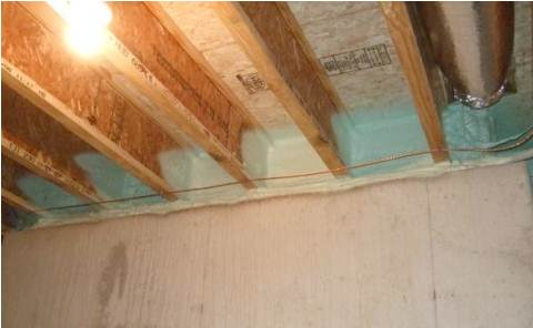 Spray foam provides a critical seal between the subfloor, rim joist, and sill plate