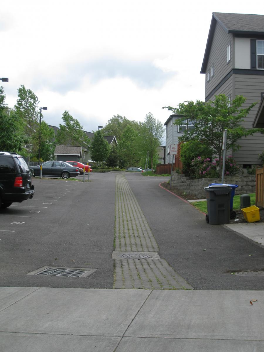 The developer added pavers and drains that discharge to underground drywells to reduce storm water runoff.
