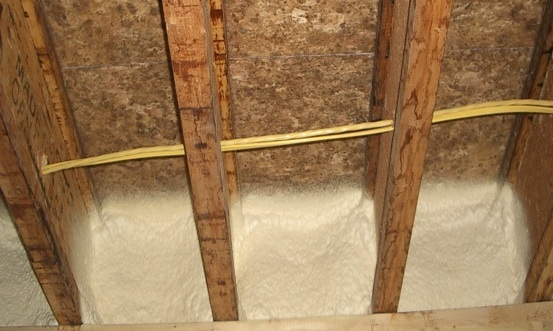 Spray foam at band joist
