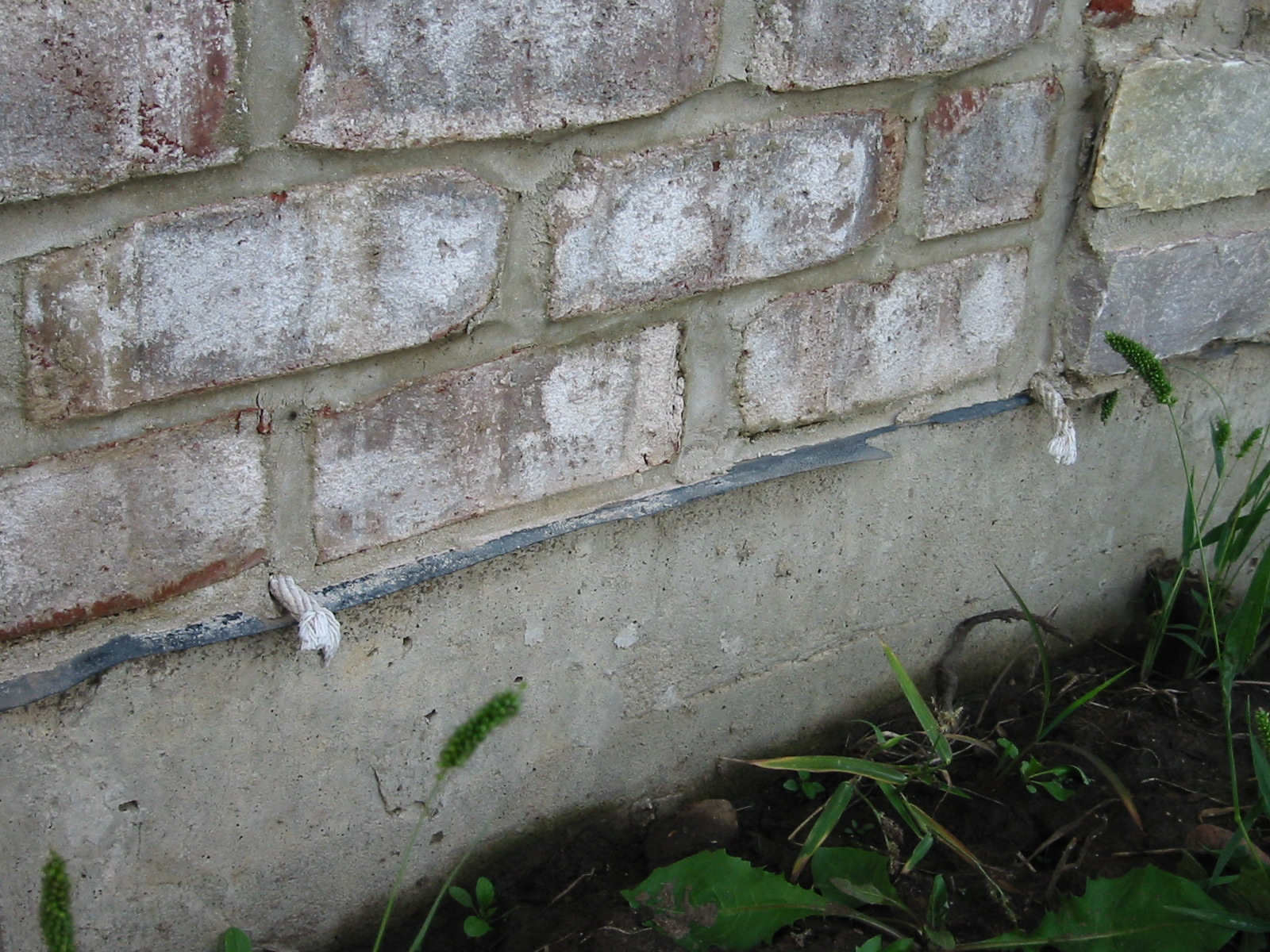 Weep holes: Rope inserted in the head joist between bricks will allow water to weep out of the base of the wall assembly