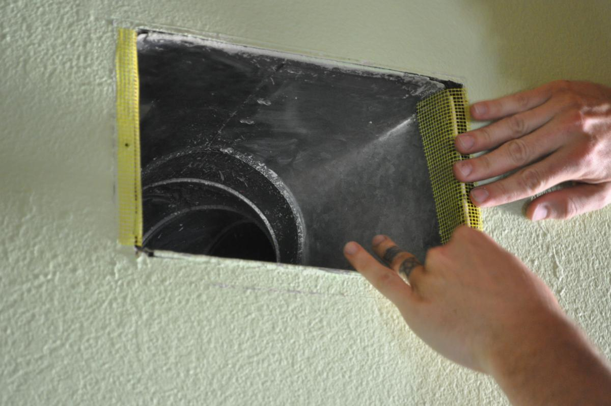 Duct boot is air sealed to ceiling by covering the seam with fiberglass mesh tape and mastic