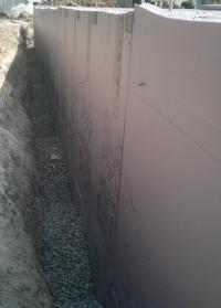 Rigid Foam Insulation Installed over Existing Foundation