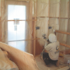 Right - Closed-cell spray foam is installed as a skim coat to provide air tightness to an exterior wall cavity before installing batt or blown cavity insulation.