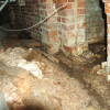 Wrong - A typical vented crawlspace in North Carolina exhibits water leakage, poor drainage, and a low-quality vapor retarder that does not cover all of the ground surface and is not sealed to the walls.