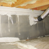 Right - This crawlspace, which is insulated on the floor, has a complete vapor barrier over the floor and up the walls that is sealed at all seams and termite inspection gap at the top of the vapor retarder. Note that penetrations are thoroughly sealed with mastic.