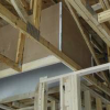 Modified truss to allow for raised ceiling sections for ducts