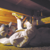 Right - An installer uses canned spray foam to air seal joints in an existing subfloor.