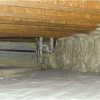 Right - Spray foam insulates and air seals the stone walls of this unvented crawlspace.