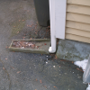 Wrong - This surface downspout run-out is directed toward the foundation instead of away from it.
