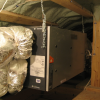 This HRV, installed in a conditioned attic, provides balanced ventilation to the whole home