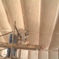 Right - A technician applies a thin layer of closed-cell foam to air seal an unvented attic assembly before filling the ceiling joists with batt or blown insulation.