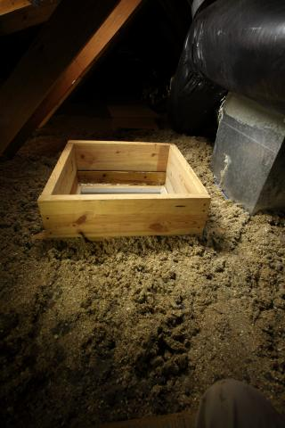 Right - A wood dam was constructed to hold back the attic floor insulation