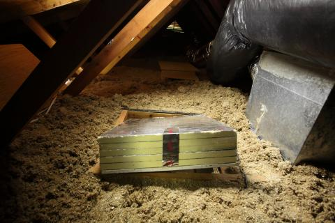 Right - This attic catch cover is insulated with rigid foam