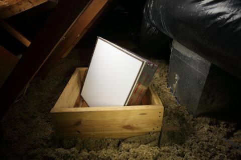 Right - The attic access panel is insulated and weather stripped and a dam is built to hold back the blown attic floor insulation