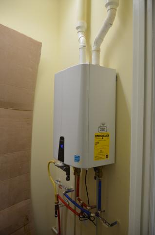 A tankless gas water heater provides continual hot water.