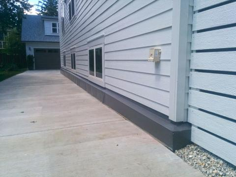 This house was designed with half of the basement above grade, allowing 36-inch-tall windows for egress and daylight on both sides of the house.