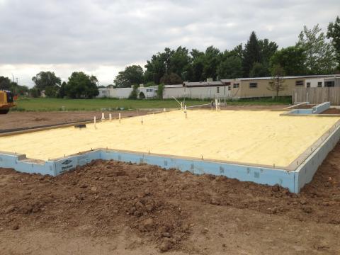 Rigid foam wraps the exterior of the foundation slab.