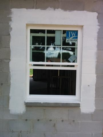 A paint-on flashing is used around the windows and doors for seamless water protection.