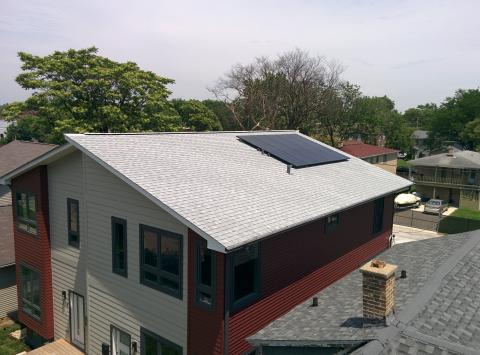 ENERGY STAR reflective shingles cover the roof, which is ideally angled for solar panels.