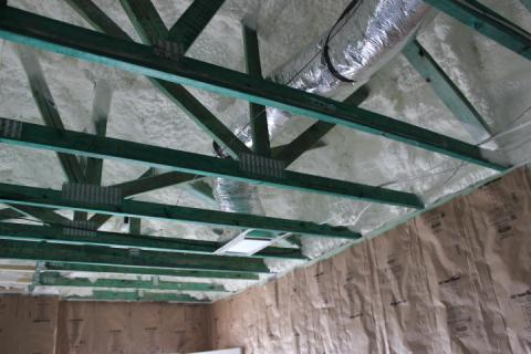 The attic is sealed and insulated along the underside of the roof deck with 5.5 inches of polyurethane spray foam, providing conditioned space for the HVAC system.