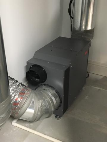 A whole-house dehumidifier is connected to the return side of the HVAC system.