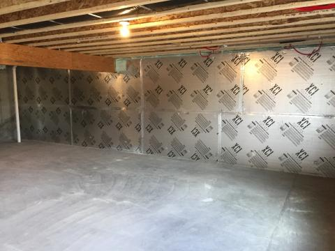 The conditioned basement is insulated on the interior with 1 inch of polyiso R-6.3 rigid insulation.