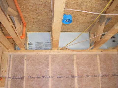 Insert rigid blocking pieces into each joist bay and fasten with caulk or nails