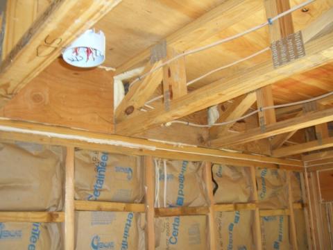 Foam holes in open-web floor trusses to completely seal the rim joist