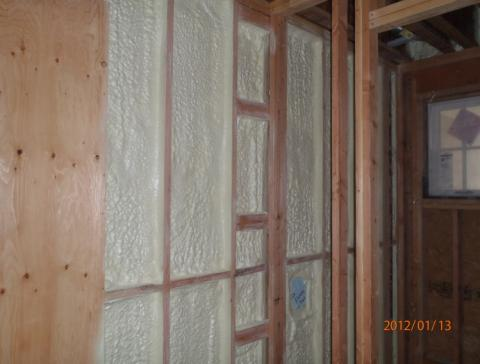 Right – Closed-cell spray foam insulation in the shared wall helps to air seal the wall and protect  occupants from garage pollutants