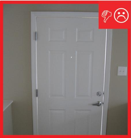 Wrong – There is visible light around the door because no weather stripping has been installed