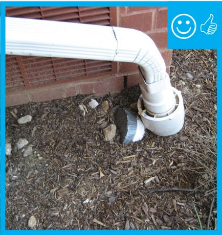 Right – The downspout terminates into a catchment system that moves water away from the foundation of the house