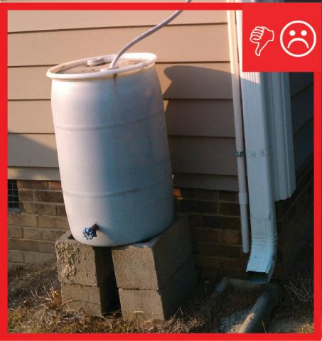 Wrong – Rain barrel installed without an overflow spout that terminates away from foundation