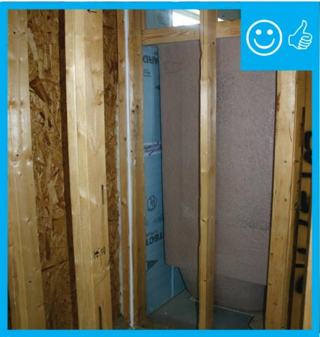 Right – Foam board taped at seams installed behind shower enclosure