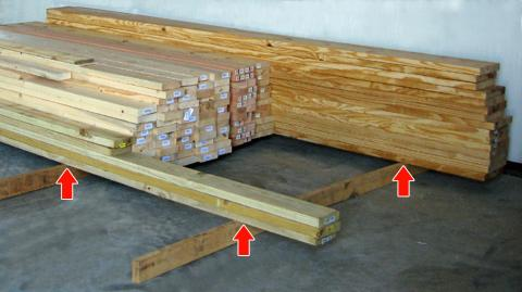 Elevate stored lumber
